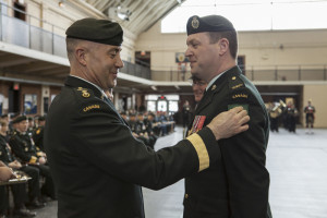 "Lieutenant-Colonel Mark Parsons, Commanding Officer, 21 Electronic Warfare Regiment, receives the green patch – the symbol of 4th Canadian Division – during the stand-up ceremony of 4th Canadian Division at Fort York Armoury, on April 26, 2014. The patch is to be worn on the left shoulder of the service dress jacket of every soldier in the Division. ""Time and again, soldiers of this Division have been ready to serve Canadians. I know that every solider of 4th Canadian Division will be proud to wear the green patch, a symbol that many veterans would recognize."" – Brigadier-General Omer Lavoie, Commander, 4th Canadian Division #strongproudready Lieutenant-colonel Mike Parsons, le commandant du 21e Régiment de guerre électronique, reçoit l'écusson vert, symbole de la Division, pendant la cérémonie d'inauguration de la 4e Division du Canada au manège militaire Fort York, le 26 avril 2014. Chaque soldat de la Division devra le porter sur l'épaule gauche sur la veste de tenue de service. « Maintes et maintes fois, les soldats de la 4e Division du Canada se sont tenus prêts à servir les Canadiens. Je sais qu'ils seront tous fiers de porter l'écusson vert, un symbole que de nombreux vétérans reconnaîtront. », a déclaré le Brigadier-général Omer Lavoie, commandant de la 4e Division du Canada #FortFiersPrets"